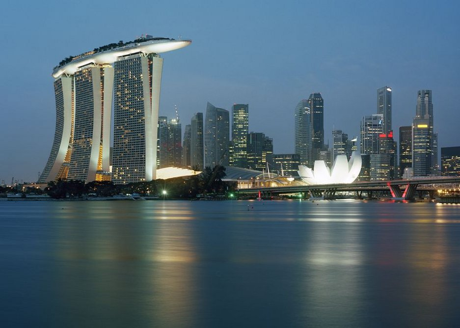 Marina Bay Sands, Singapore dominating the skyline in the view from the water.
