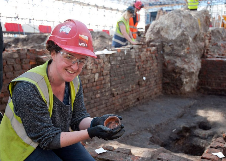 MOLA archaeologist Sarah Trehy excavating the exceptionally well preserved remains of the Curtain.