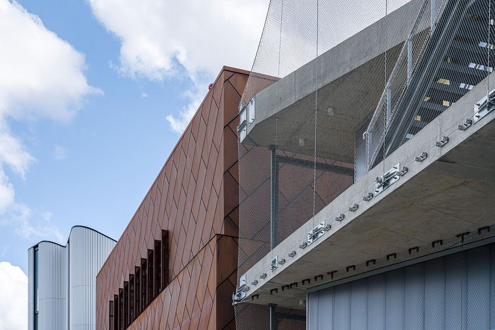 Mole Architects' weathering steel-clad building is flanked by further spaces for the creative industries designed by Architecture 00 (right) and HNNA (left).