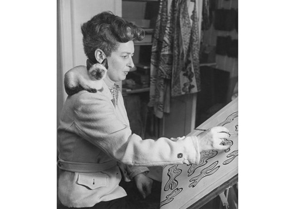 Enid Marx working on a textile design post-1945.