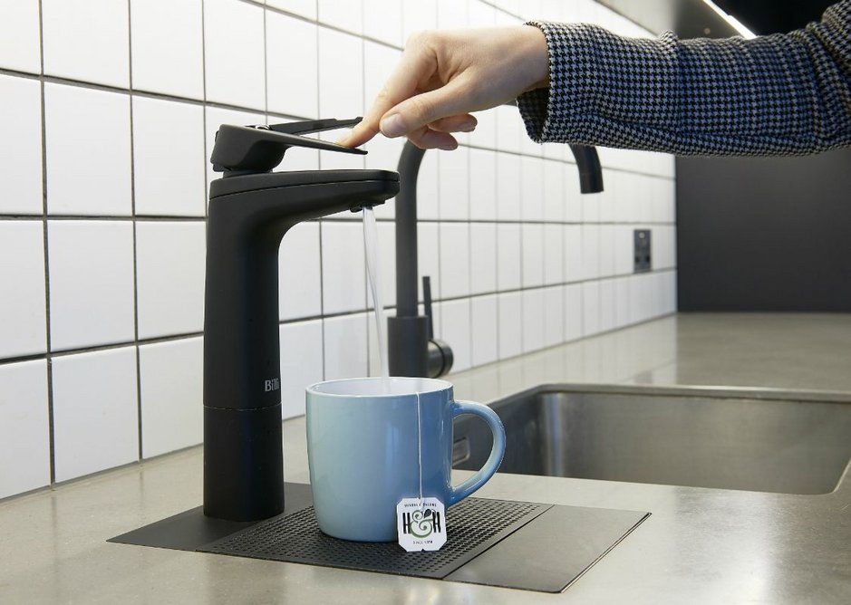 Billi Quadra Plus combines boiling and chilled filtered water through the XL lever dispenser in Matte Black (front) and hot and cold water from a Gooseneck Sink Mixer Tap (back) in matching finish.