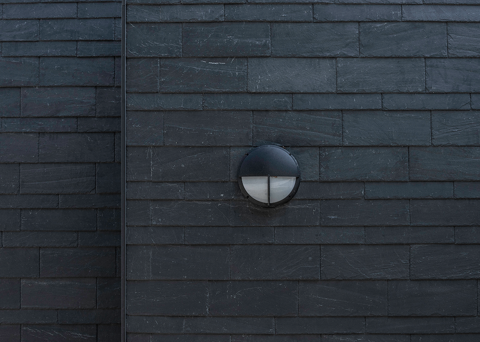 Cupaclad 101 Random features invisible fixings that make the natural slate the main attraction of the facade.