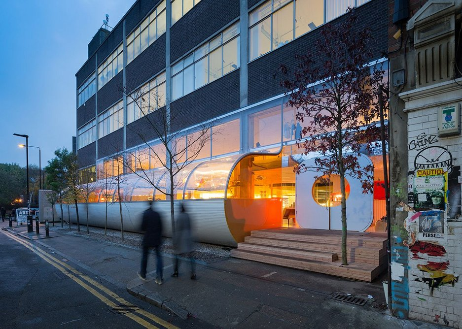 Orange dining is the outward expression of change to a very plain 1970s facade.