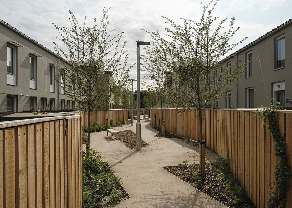A sociable shared space or ginnel sits between back gardens.