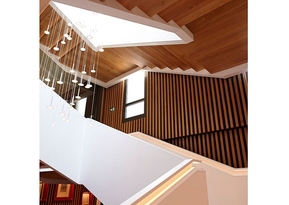 'A combination of elegant mass and firm airiness': The staircase rises through the atrium.