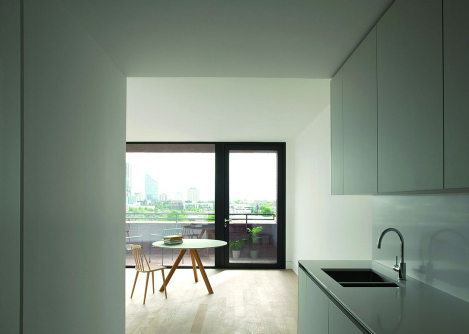 Entering the apartments via the kitchens, with direct views out through the living rooms.