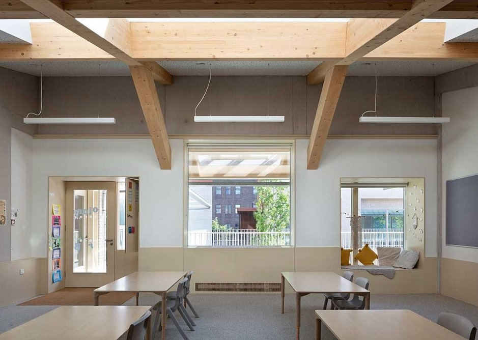 Internal corridors at Hackney New Primary School were exchanged for cloisters and covered open walkways around a courtyard.