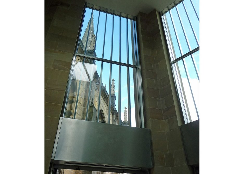 Inside the new entrance. Large windows are disguised externally by vertical stainless steel brise-soleil.