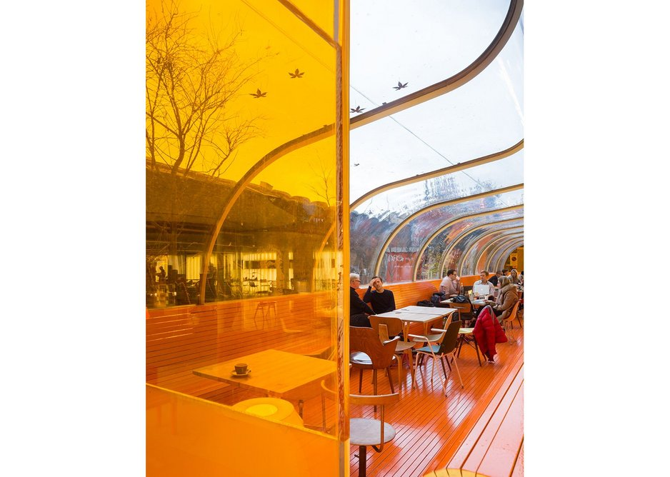 Rolls of orange slates turn floor into benches into dividers.