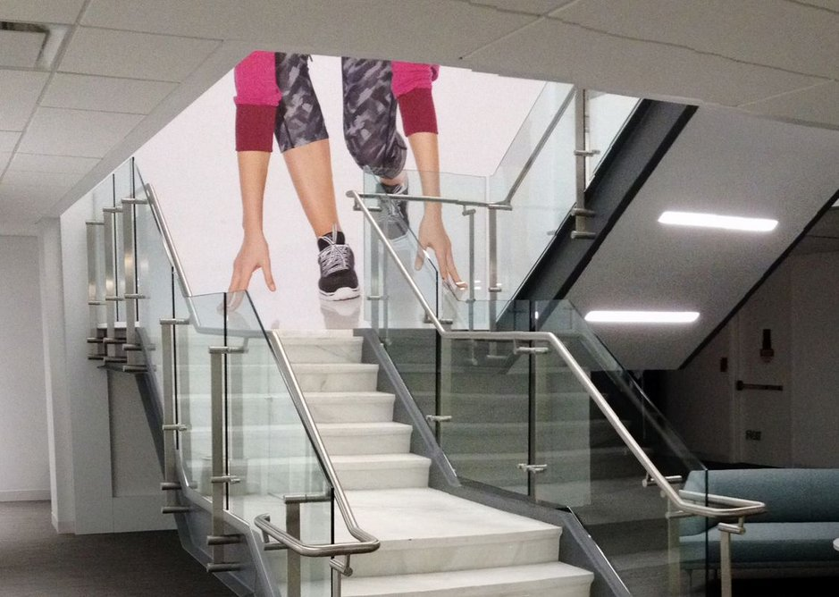 Minimalist design realised through invisible engineering: Kubit balustrades at the New York corporate offices of clothing retailer Fullbeauty Brands.