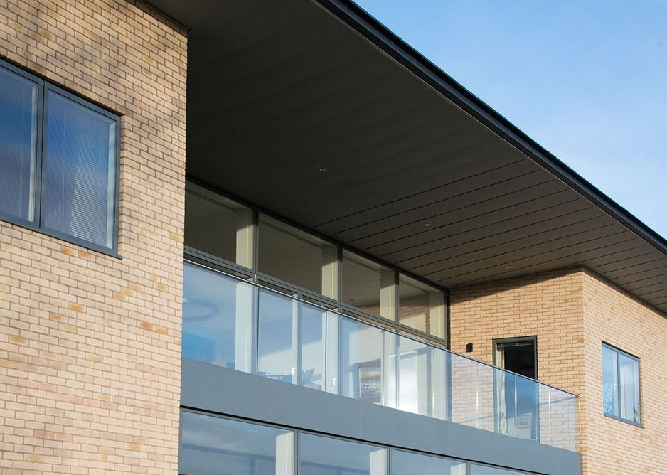 Full height glazed units with a large bi-parting door provide an unobstructed opening onto the balcony.