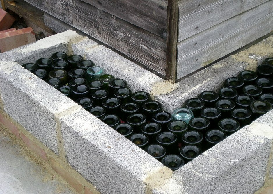 Glass bottles were donated by locals to create the wall structure of the new village hall.