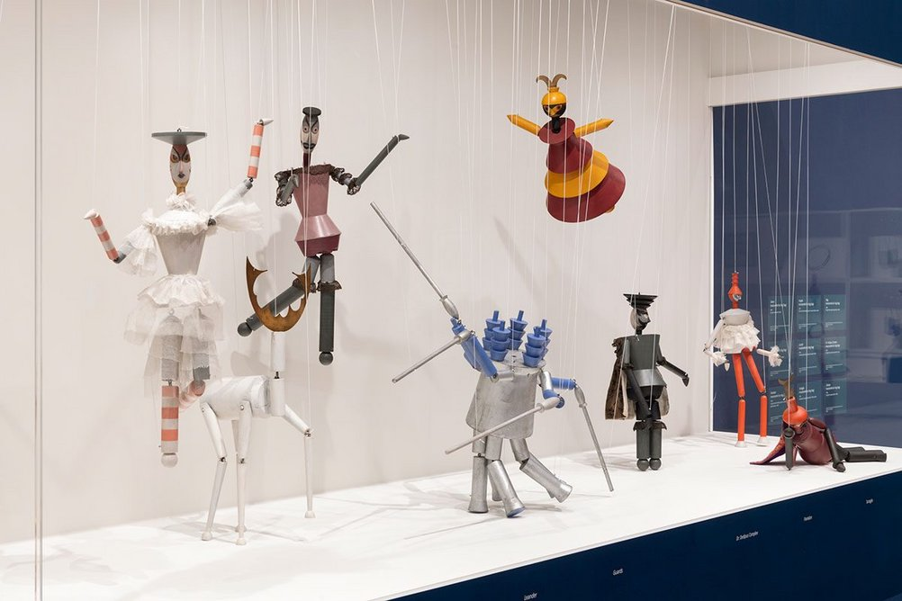 Installation image of the exhibition Sophie Taeuber-Arp showing marionettes designed by her for the performance of the play King Stag in 1918.