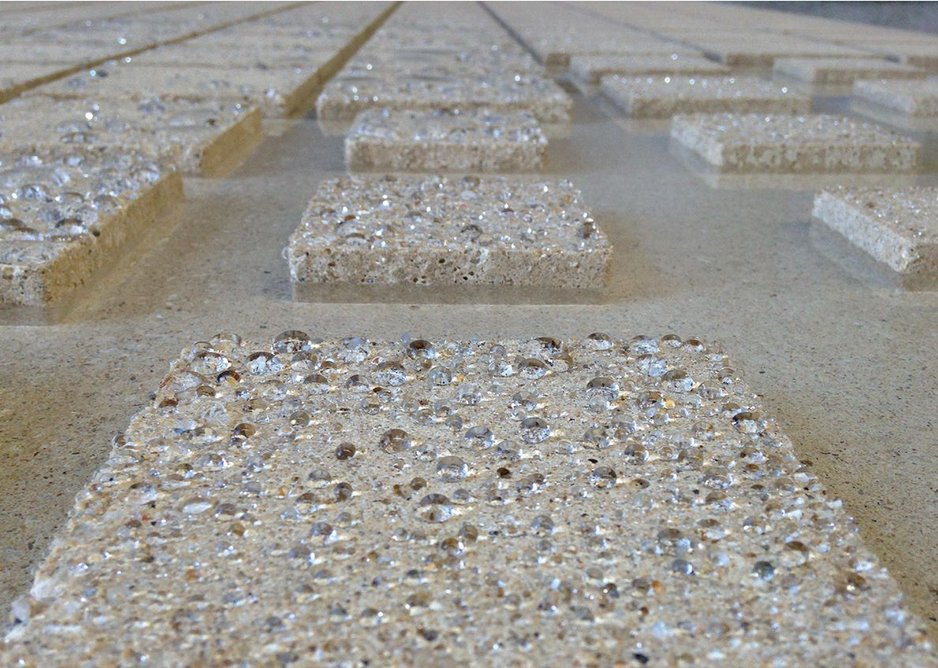 Close-up of a concrete panel showing the exposed aggregate detail.