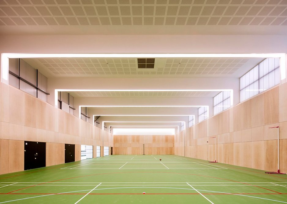 A new steel frame structure was built on the roof to create the sports hall.