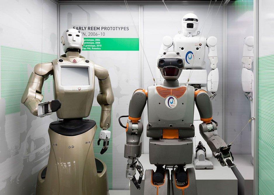 Three early REEM prototype robots.