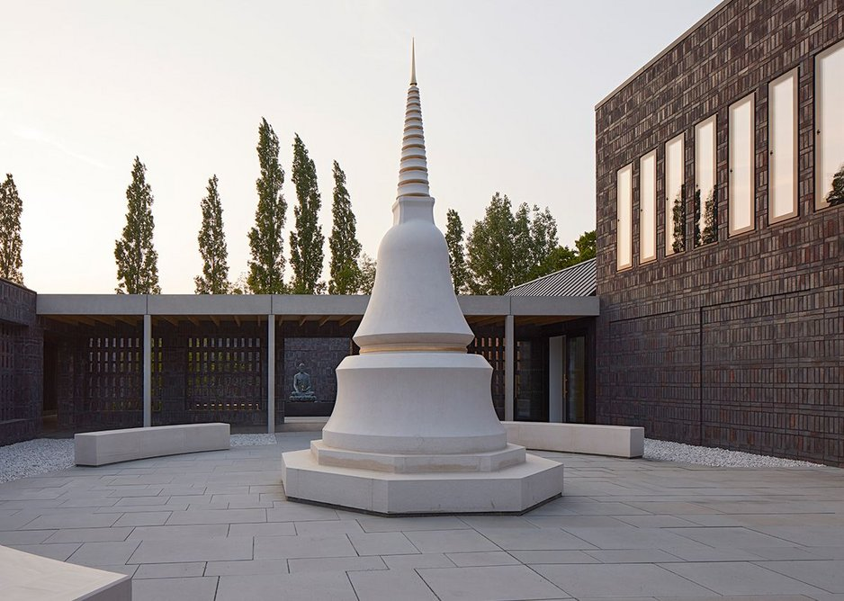 A Portuguese Limestone stupa sits in one of the two Dharma jewel courtyards.