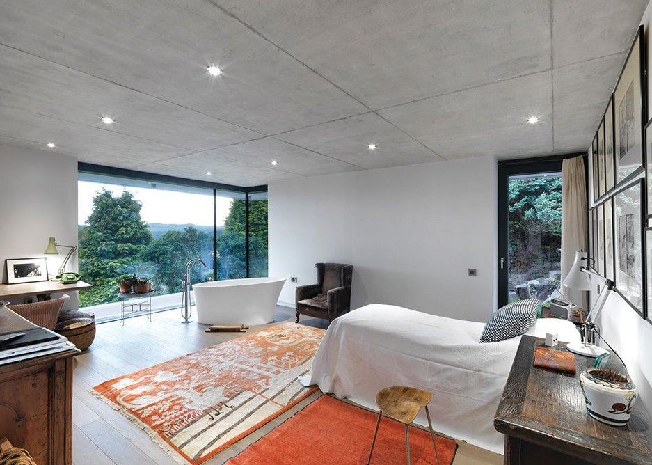 A scene of intimacy and exposure: the bedroom's bath has stunning views over the Wye Valley.
