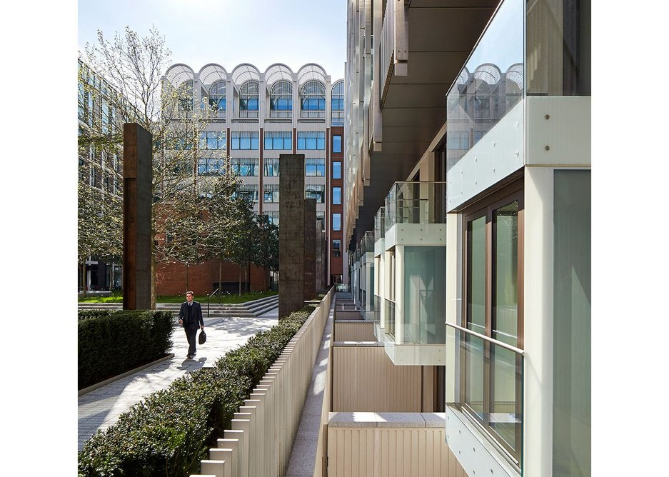 The public are held at a distance from lower ground floor flats by fencing, hedges and Corten verticals.