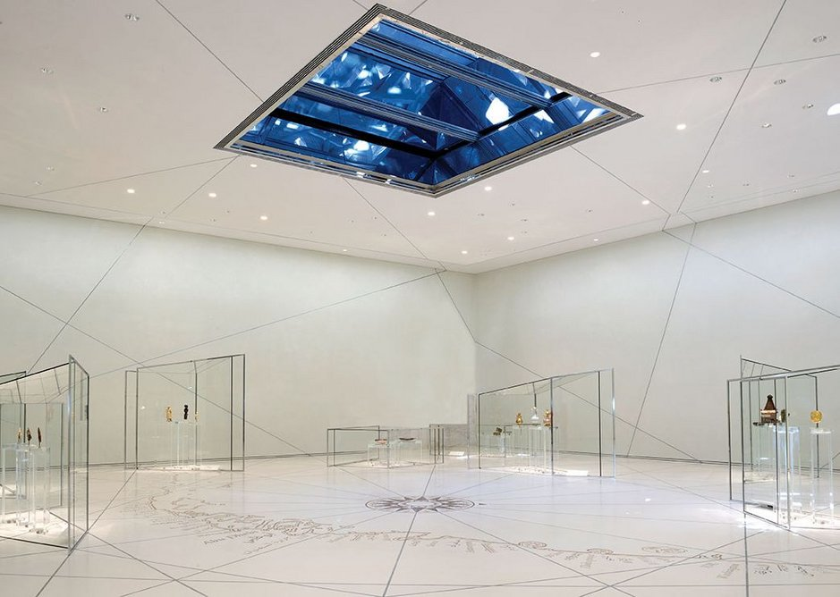 The Grand Vestibule; white, minimalist, with small groupings of exhibits in delicate, bespoke vitrines, sets the tone of the whole gallery experience.
