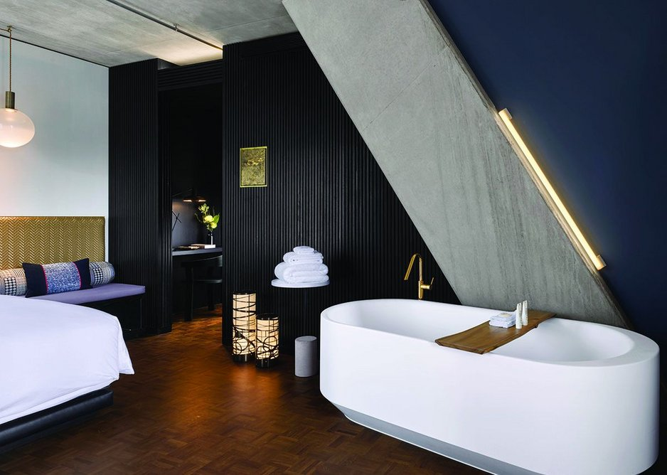 Everything subjugates to concept architect Ron Arad's diagonal concrete structure. Here luxury Laufen baths populate the free space of the bedroom.