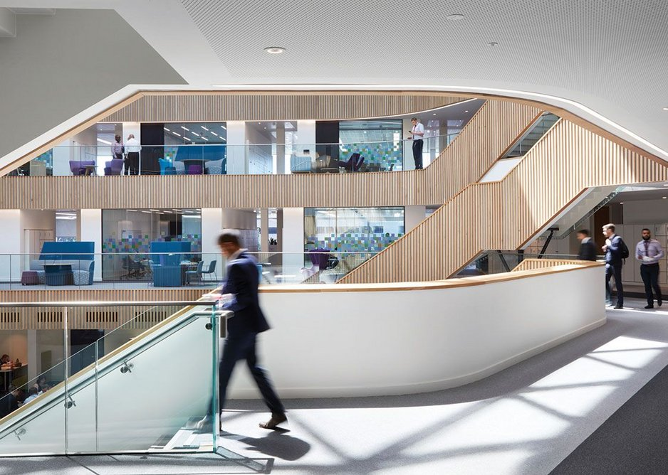 At leaving time the atrium buzzes with conversation as the staff flow down the stairs.