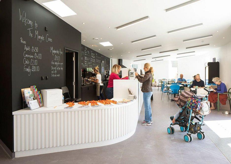 A long single counter serves as reception, shop and café.
