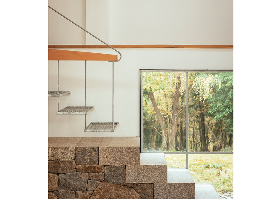 Stone and steel stairs ascend to the Winter Studio.