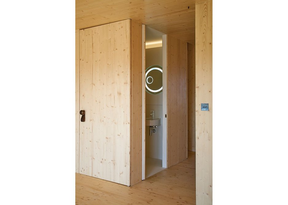 At Amin Taha and Groupwork's Barratts Grove housing, the rich, warm, timber cladding outside the bathroom is counter pointed by 2001-like stark whiteness within – tile free to cope with structural movement.
