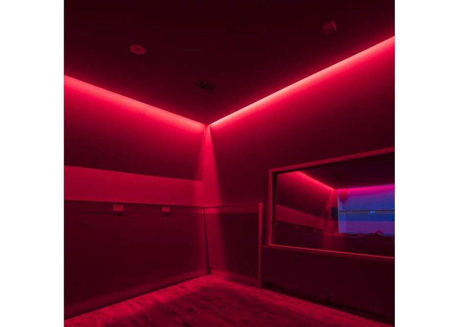 Sensory room lit in red.