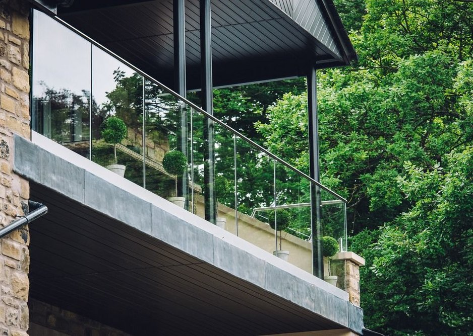 Q-railing's Easy Glass Pro is installed from inside the balconies at Tall Tree Gardens and provides maximum safety.