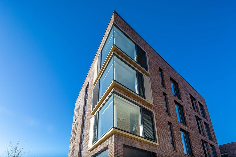 The student accommodation has feature corner windows by Senior Architectural Systems.