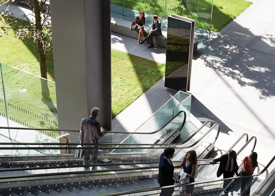 Looking down the escalators into the public space below the building.