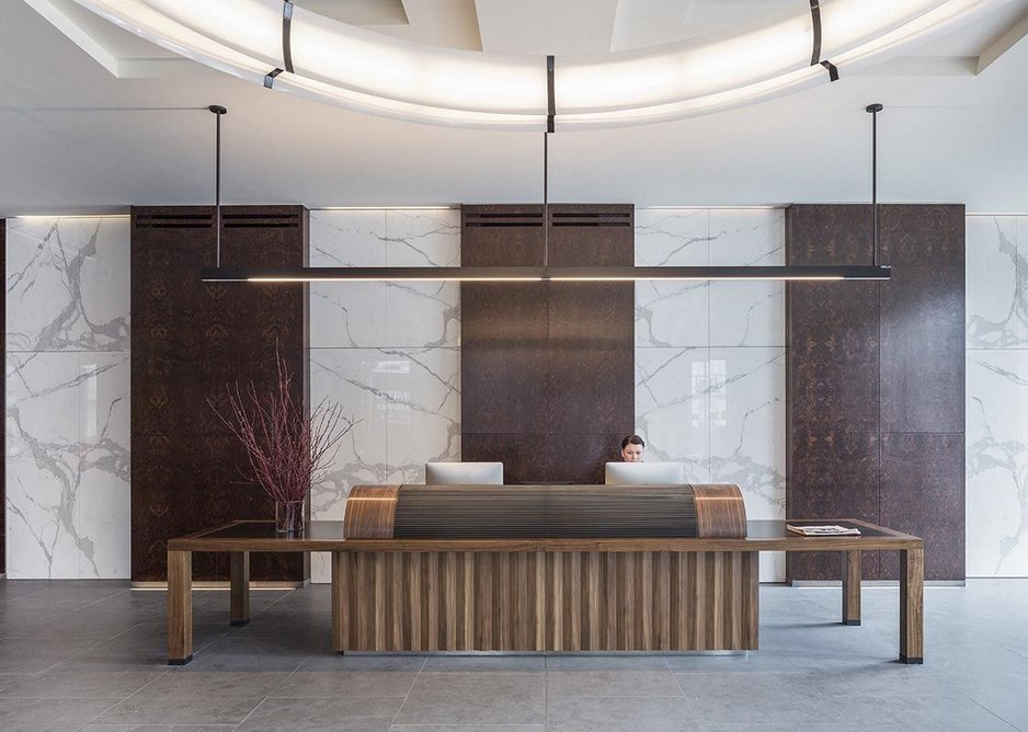 A giant roll top writing desk as a reception