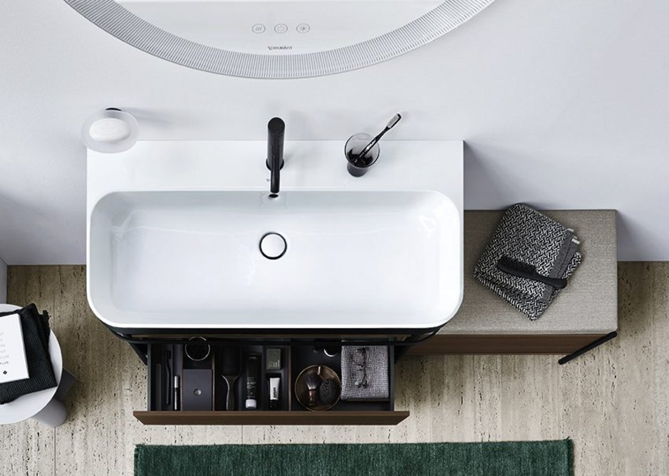 The metal console in Black Matt can be optionally expanded to include a drawer and a seat unit either on the left or right, all available with 11 different Happy D.2 Plus surfaces. Tap from the C.1 series.