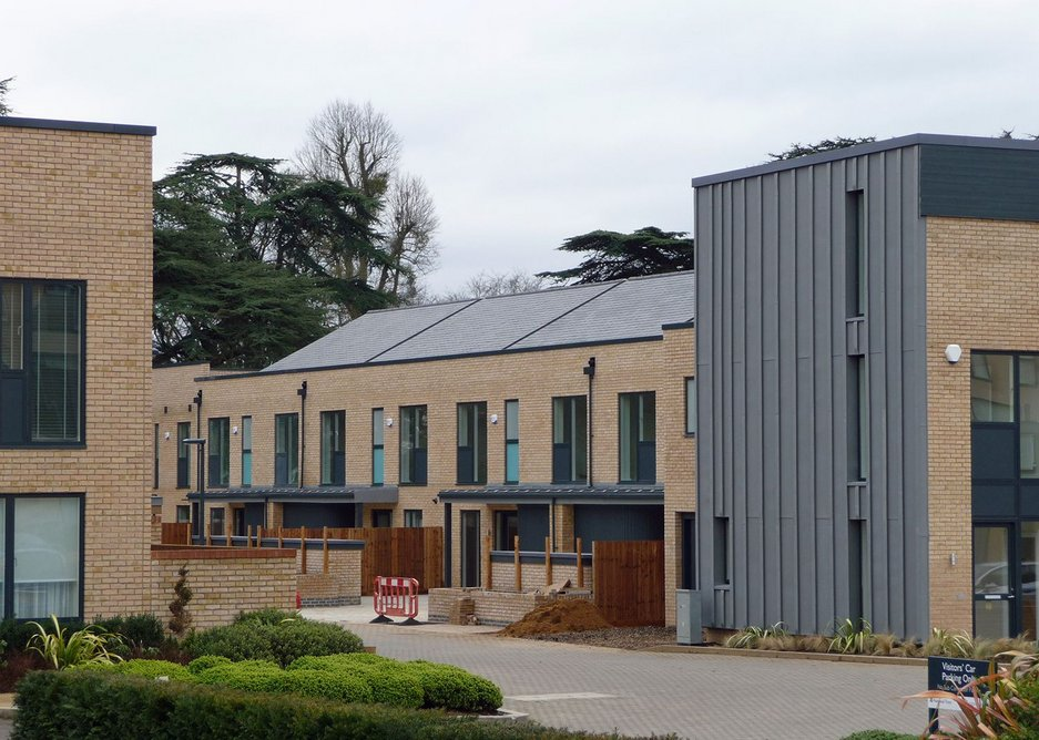Last phase to complete – note pitched roofs set back behind parapets.