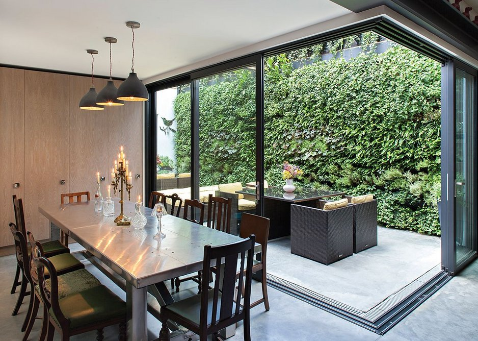 A moveable corner post allows the ground floor flat's rear elevation to open to the newly created courtyard.