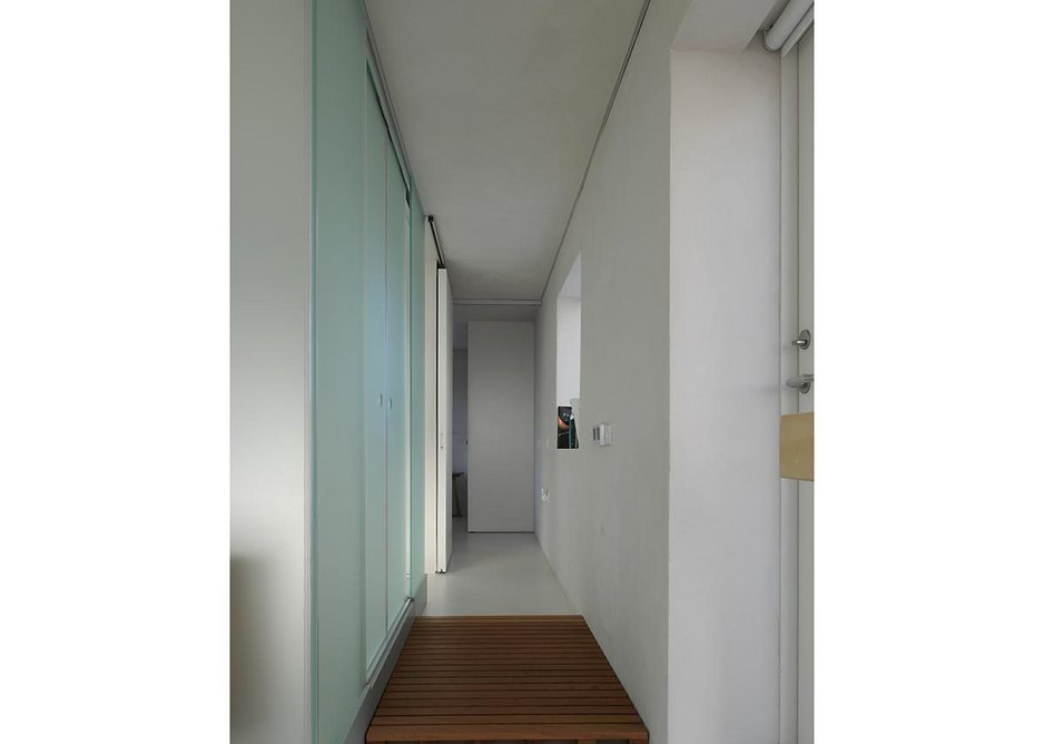 Rearward view along the upstairs landing, past the glass box twin shower room.