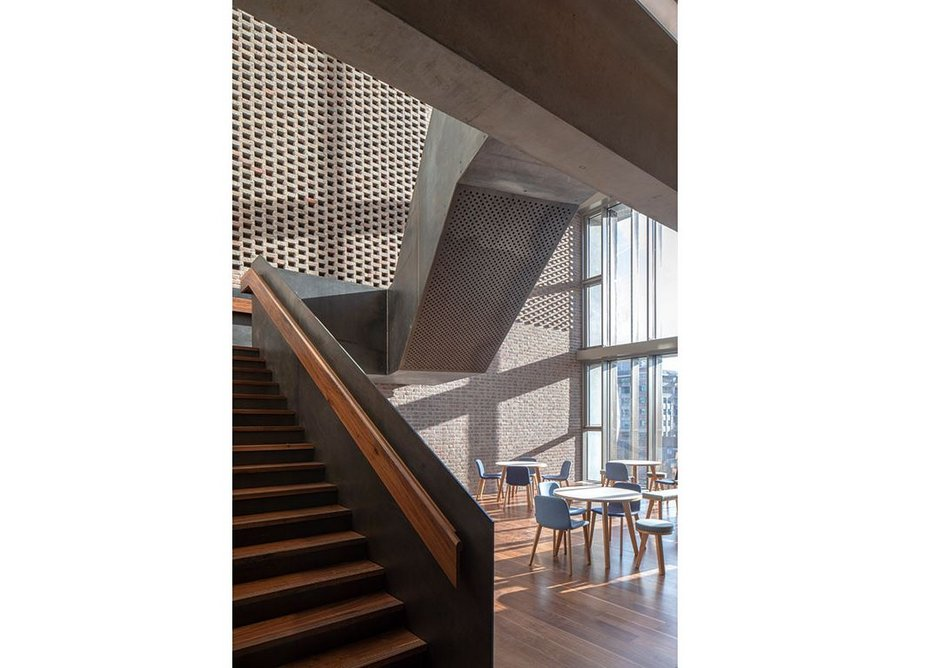 Steel is softened with timber treads and handrails.