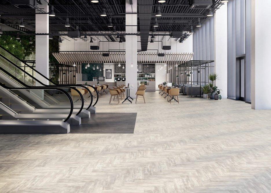 Herringbone wood-effect Halo Pine and stone-effect Stria Volcanic Signature 36+ luxury vinyl tiles.