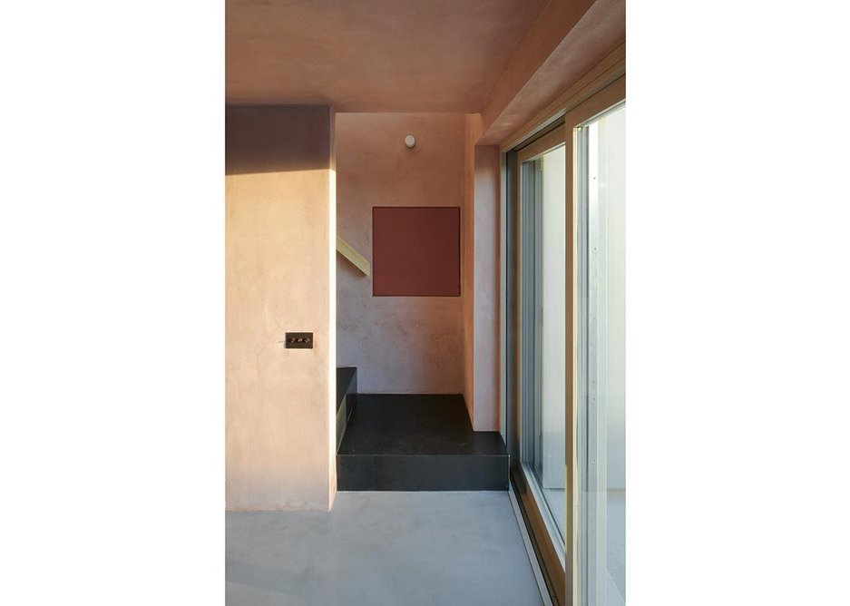 Clay plaster, polished concrete floor,  steel stair, wood handrail and window frame make a composition of colours and textures.