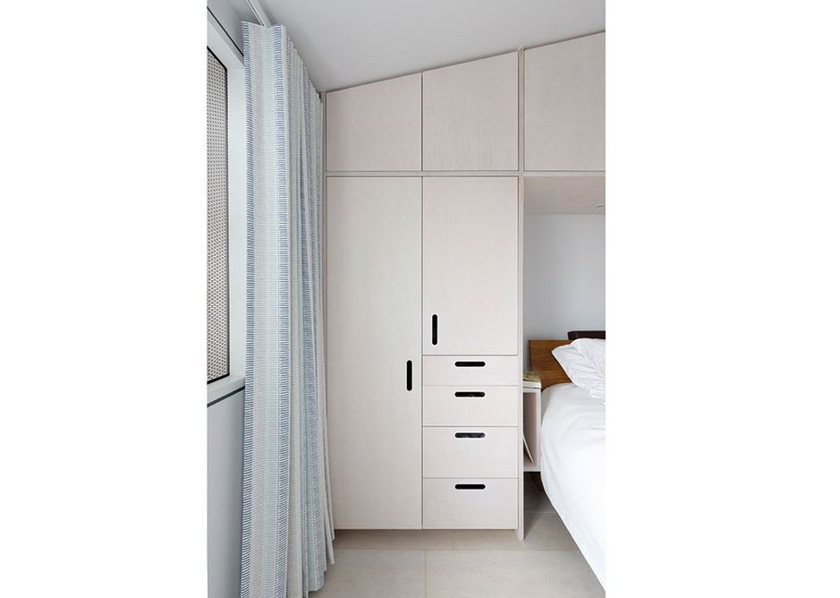 The bedrooms are functionally arranged to maximise storage space.