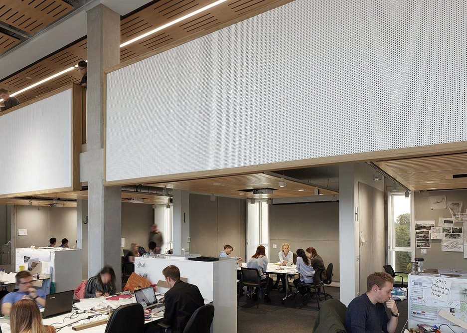 A mezzanine floor and offices runs over crit spaces where tutors can also teach small groups or offer guidance away from the busy desks.