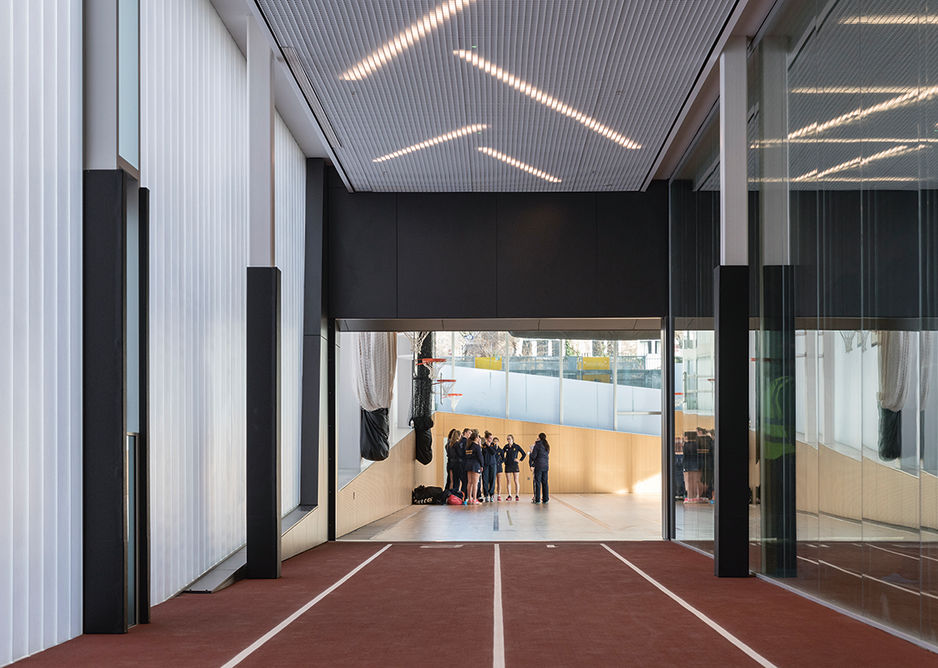 Ground floor twolane 25m speed training running track and sports hall in distance.