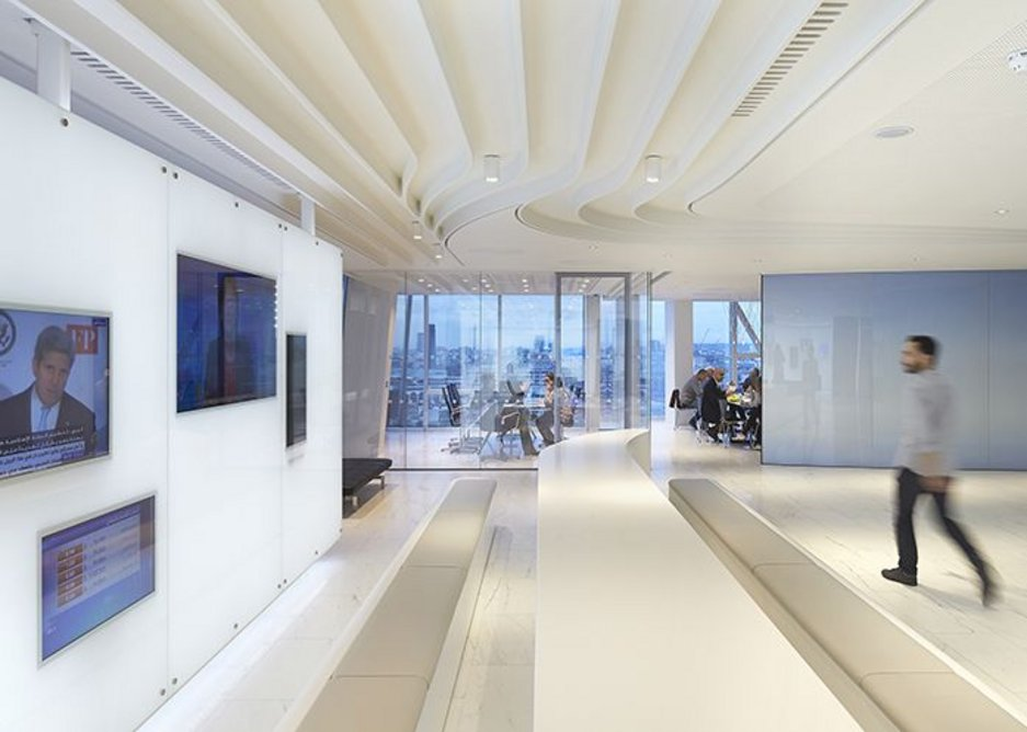 The sleek table in reception follows the sinuous contours of the ceiling.