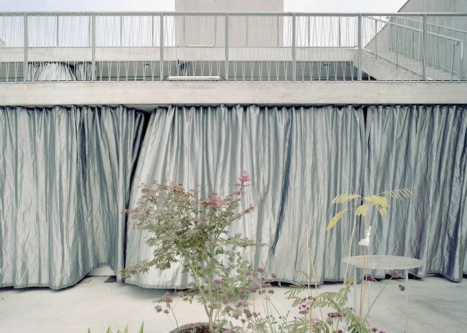Heavy duty silver geotextile curtains act as a solar shade, allowing a diaphanous light into the interiors.