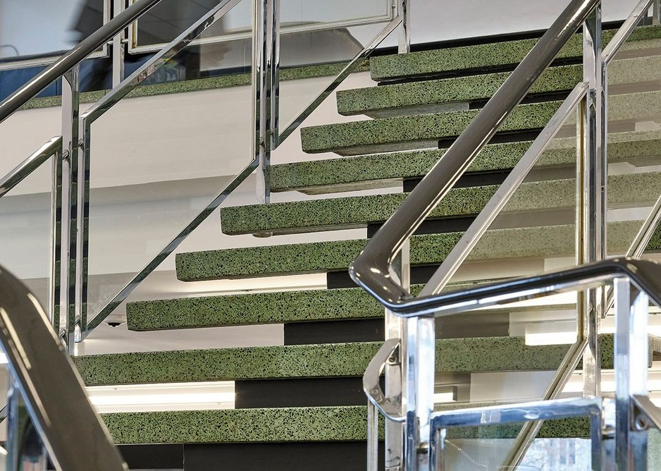 The terrazzo tread staircase to the upper balcony of the lending library.