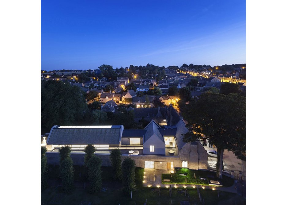Few elevations, few windows but many rooflights at Burford's community centre as this night shot shows.