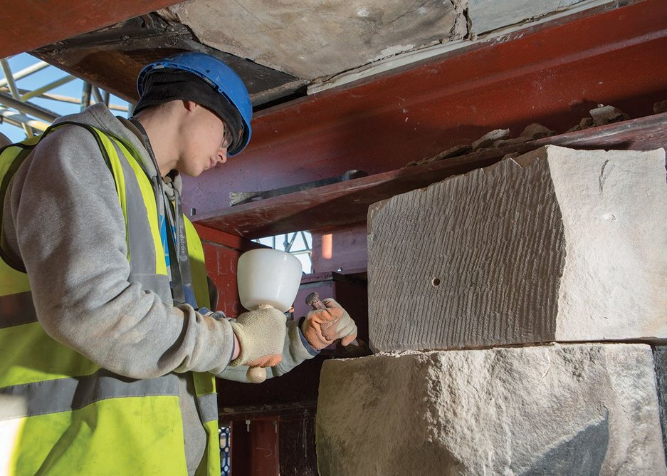 An apprentice stone mason tools new Giffnock sandstone for the west gable wall.