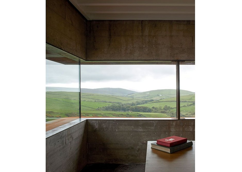 Slot window and concrete bunker walls make the interior feel sheltered.
